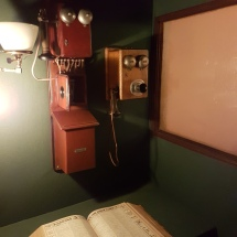 An early telephone in a separate felt-lined room